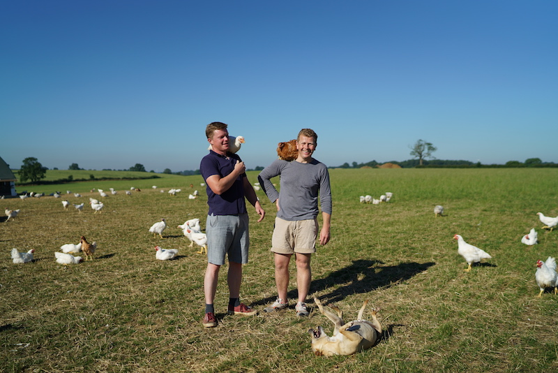 Slow-grown chicken farmers Nick & Jacob at their farm, Fosse Meadows. A world away from supermarket chicken
