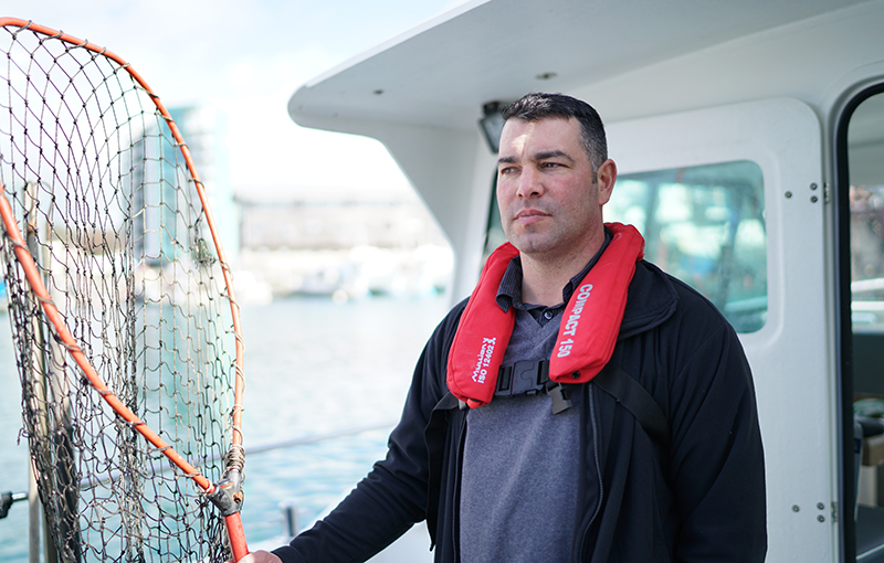 Aaron Lidstone on his boat Happy Days, its named coined from the catchphrase of a fellow fisherman who had positive outlook each time he set off for a catch
