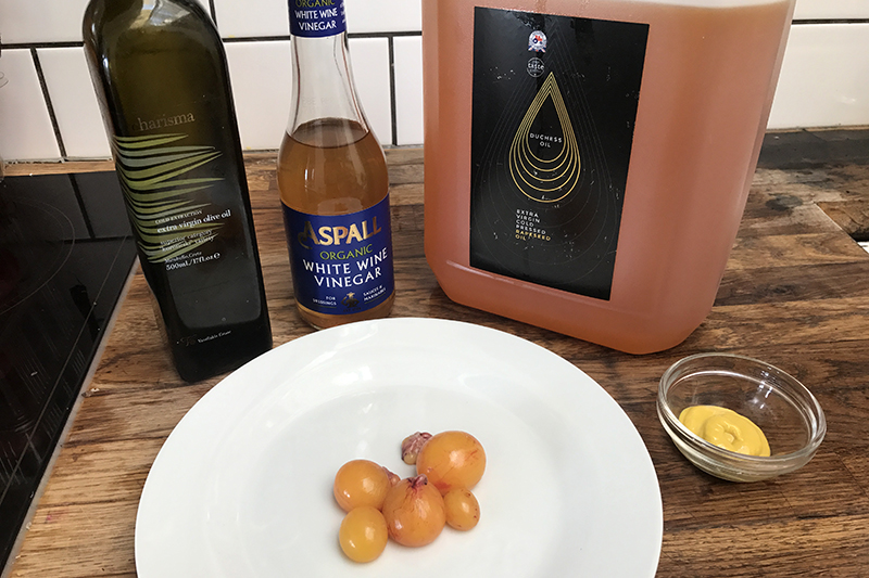 Olive oil, white wine vinegar, rapeseed oil and mustard (l-r) hanging out with unlaid eggs.